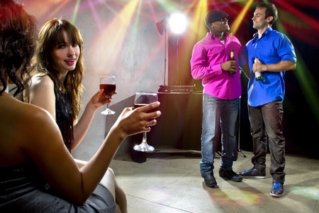 dancefloor: mixed crowd drinking and socializing in a nightclub