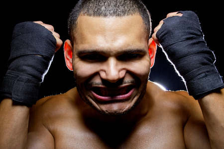 intense: portrait of a latino mma fighter with intense expression