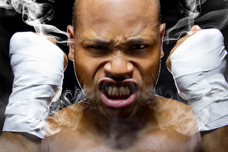 outrage: portrait of a fighter who is smoking or steaming from intensity Stock Photo