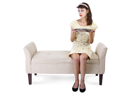 woman seated on a chaise holding a blank tray for composites photo