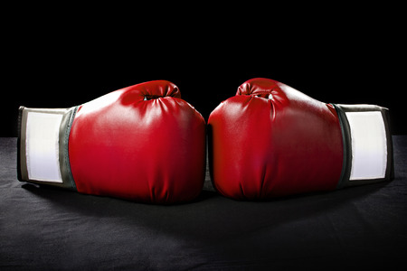 martial: boxing gloves or martial arts gear on a black background Stock Photo