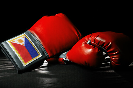 boxing equipment: boxing gloves or martial arts gear on a black background Stock Photo