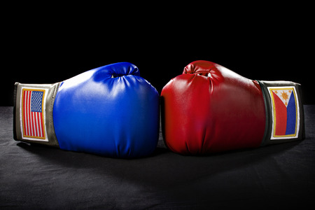arts: boxing gloves or martial arts gear on a black background Stock Photo