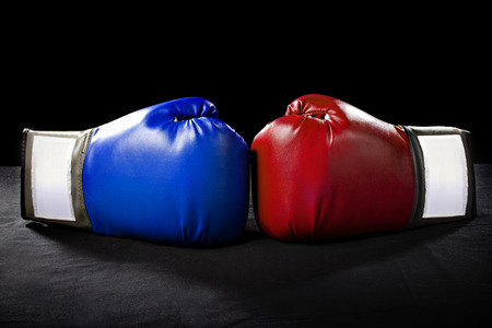 boxing gloves or martial arts gear on a black background Archivio Fotografico
