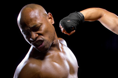 punched: mma fighter or boxer losing and getting hit in the face