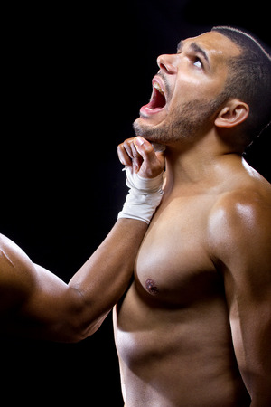 beat the competition: mma fighter or boxer losing and getting hit in the face