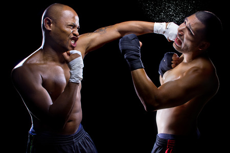 knockout: sparring mma fighters or boxers punching each other