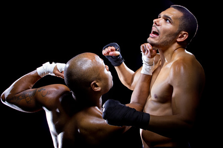 bout: sparring mma fighters or boxers punching each other