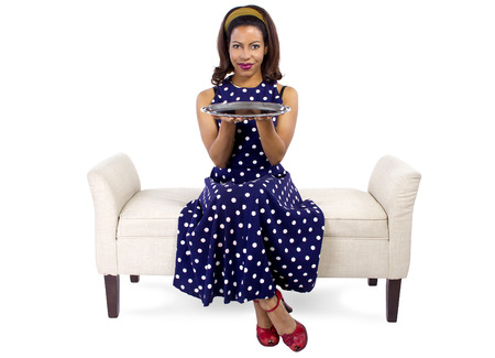 young black girl holding an empty tray sitting on a chaise lounge photo