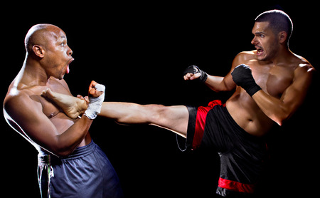 arts: mma fighter performing a counter attack from a kick Stock Photo