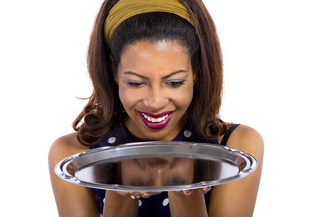 fascination: young black female holding an empty tray for composites