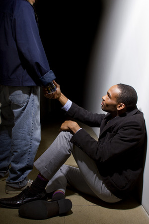 lift hands: man helping a depressed fellow by offering a helping hand