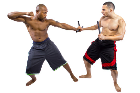bout: two martial artists sparring with Kali Escrima or Arnis