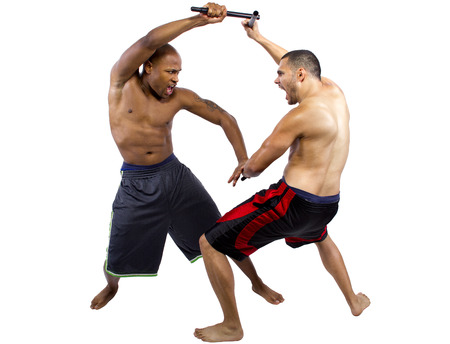 two martial artists sparring with Kali Escrima or Arnis