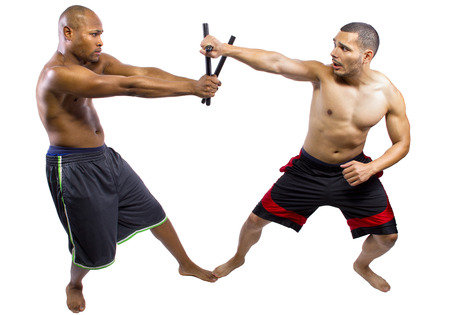 weaponry: two martial artists sparring with Kali Escrima or Arnis