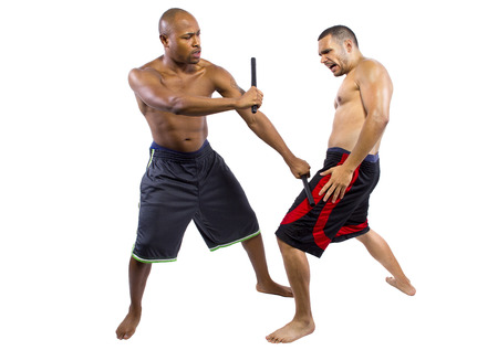 kali: two martial artists sparring with Kali Escrima or Arnis