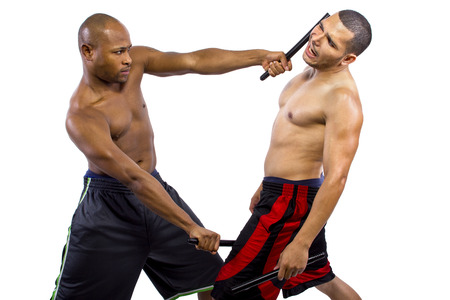 martial artist: two martial artists sparring with Kali Escrima or Arnis