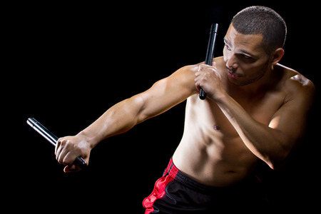 man demonstrating Filipino stick fighting martial arts Stok Fotoğraf