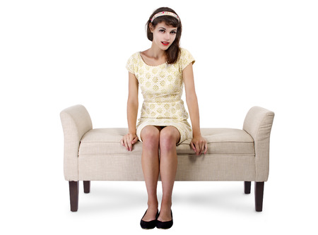 love seat: Stylish retro female sitting on a chaise lounge or sofa on white background