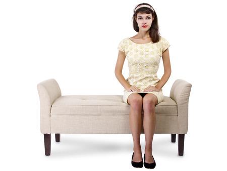 lounge: Stylish retro female sitting on a chaise lounge or sofa on white background