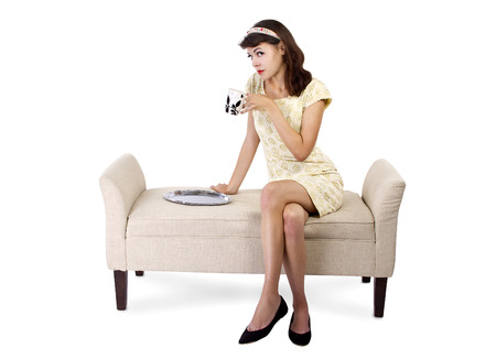 chaise lounge: young female sitting on a chaise lounge and drinking coffee on a silver tray