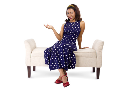 textspace: young black female on a chaise lounge with advertising gesture