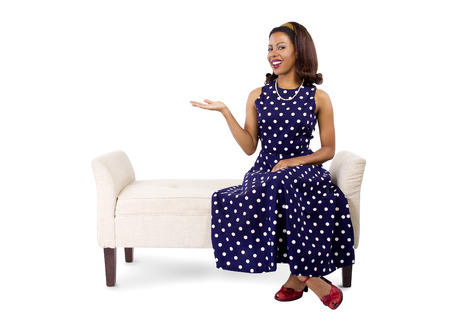 chaise lounge: young black female on a chaise lounge with advertising gesture