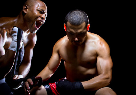 motivating: Trainer motivating a muscular Boxer or MMA fighter with pep talks