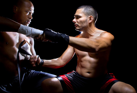 instigator: Trainer motivating a muscular Boxer or MMA fighter with pep talks