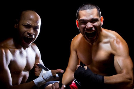 Trainer motivating a muscular Boxer or MMA fighter with pep talks