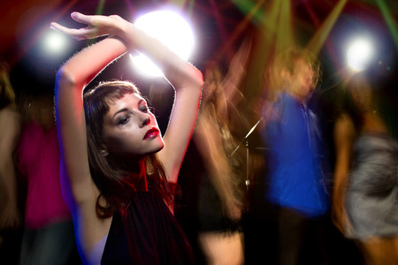 nightclubs: intoxicated female dancing at a nightclub and high on drugs or drunk