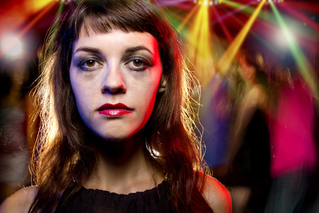 insane insanity: Disheveled drunk or female high on drugs at a nightclub