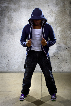 hip hop dancing: young black male dancing hip hop style in an urban setting