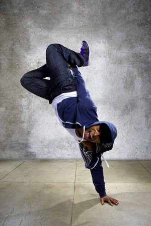 young black male dancing hip hop style in an urban setting