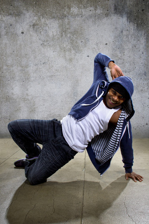 breakdancer: young black male dancing hip hop style in an urban setting