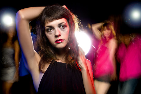 social outcast: Disheveled drunk or female high on drugs at a nightclub