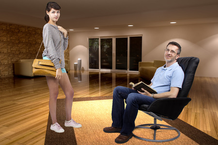 single father: Teenage daughter leaving single father to go out at night Stock Photo