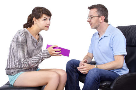 single father: Teenage daughter giving a surprise gift to her single father