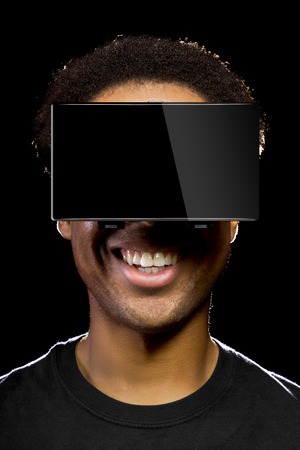 playing video games: Virtual Reality headset on a black male playing video games