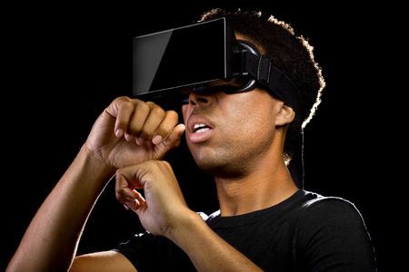 headset computer: Virtual Reality headset on a black male playing video games
