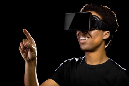 Virtual Reality headset on a black male playing video games Stock Photo - 40764332