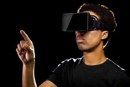 virtual technology: Virtual Reality headset on a black male playing video games