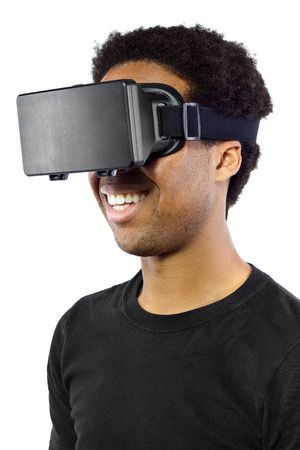 video gaming: Black male wearing a virtual reality headset on a white background Stock Photo