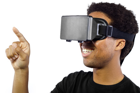 headset computer: Black male wearing a virtual reality headset on a white background Stock Photo