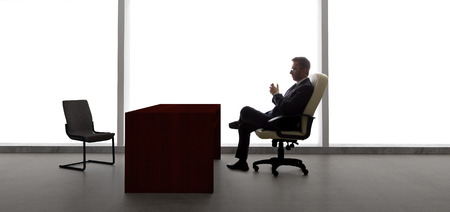 tardy: Businessman with an empty chair waiting for a late client
