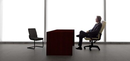 lonely: Businessman with an empty chair waiting for a late client