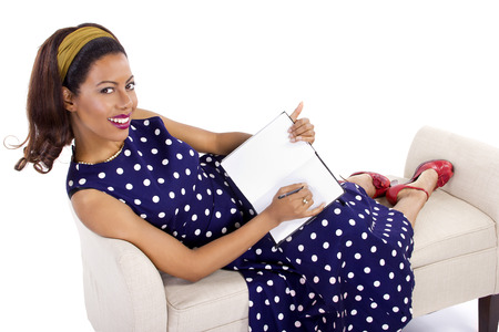 diary: Black female in vintage clothing writing on a diary on white background Stock Photo