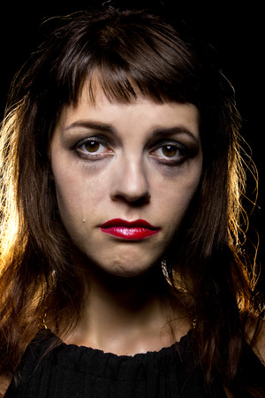 smeared: smeared make-up by crying tears on a noir style sad woman Stock Photo