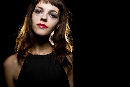 smeared: smeared make-up by crying tears on a noir style sad woman Stock Photo