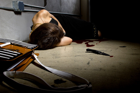 mugged: female murder victim laying on a dark alley with a bloody knife